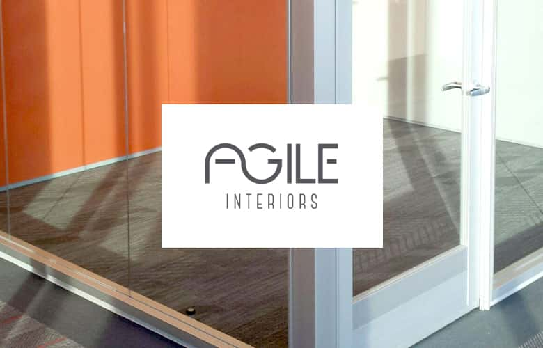 Agile Interiors logo over close up of office with glass walls