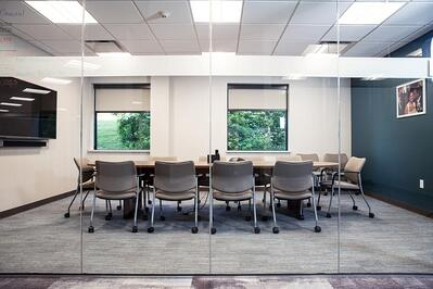 Office table and chairs with glass office walls