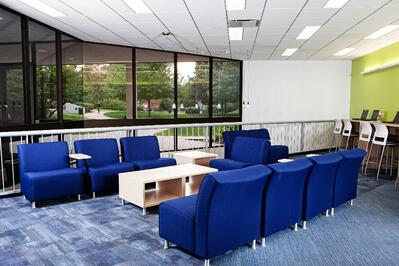 NYIT Old Westbury meeting area with glass windows