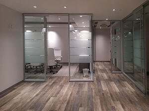 Beautiful glass office with hardwood floors