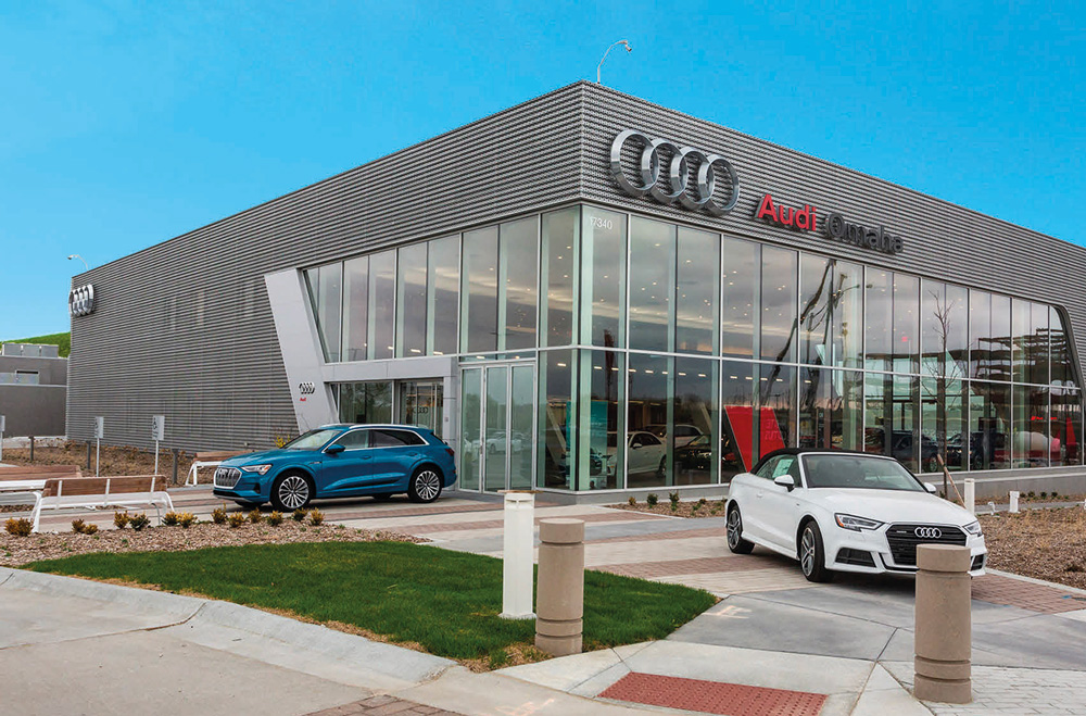 audi-omaha-storefront-with-blue-sky-and-cars-outside