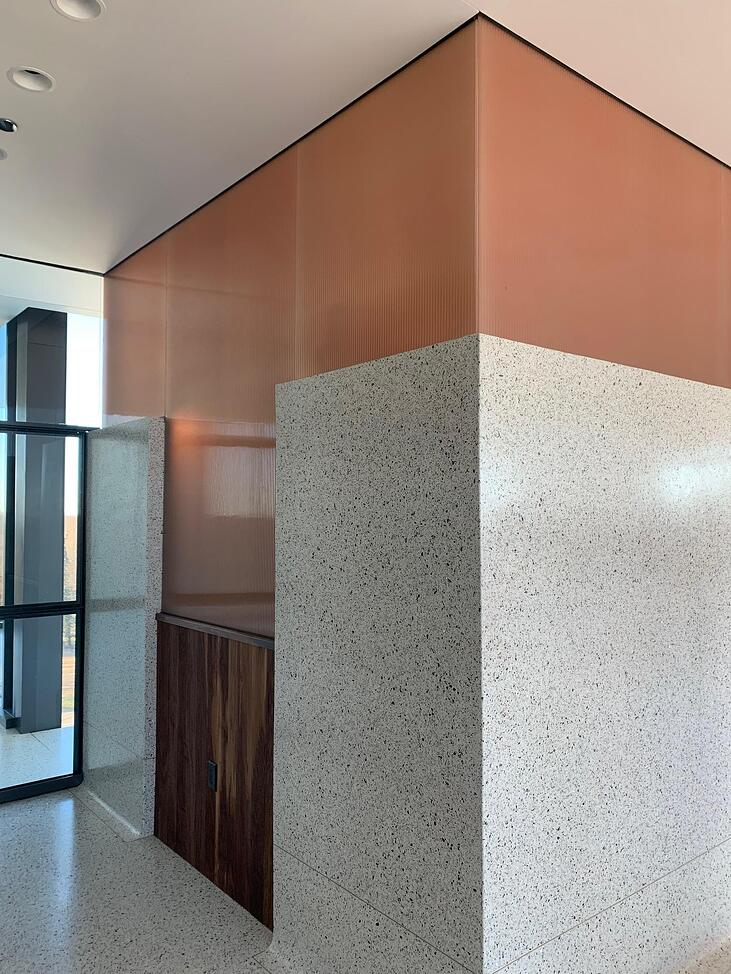 color-matched laminated glass accent wall for bar area of restaurant