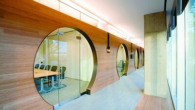 Office with circle doorways and glass doors