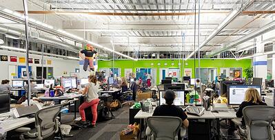 Large glass office walls in tech company headquarters