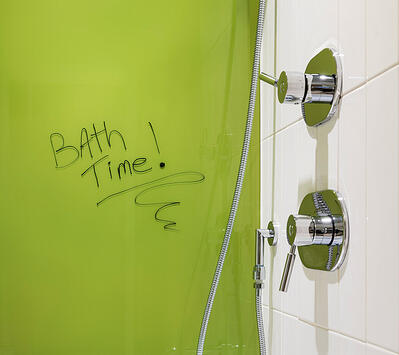 Lime back painted glass in shower