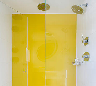 Yellow Back Painted Glass in Shower