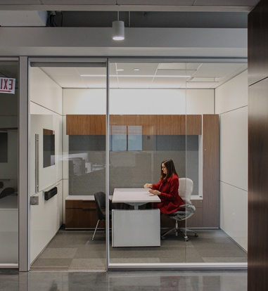 Women working in office with glass walls
