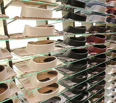 Glass shelves with dress shirts on top