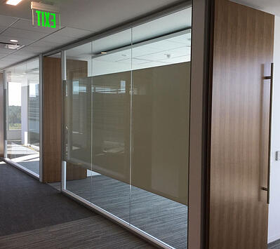 Glass office wall with middle privacy section