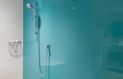 Turquoise Back Painted Glass in Shower
