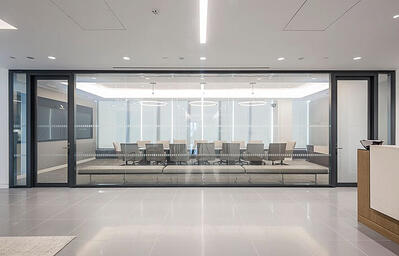 Large office with large glass office wall