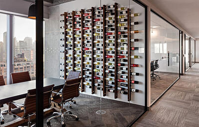Scott Spector modern office with wine bottles and glass office walls