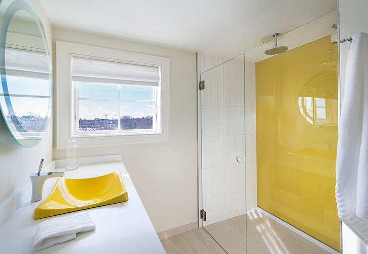 Glass shower door with yellow back painted glass