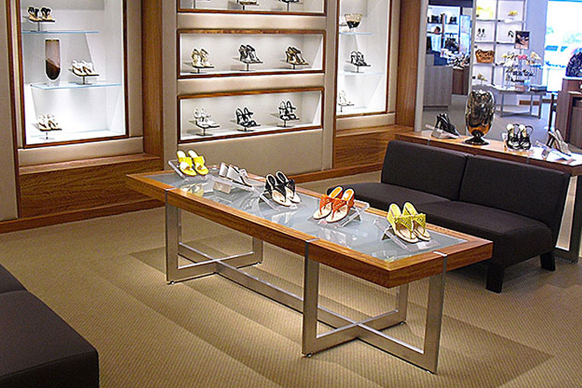 Retail glass fixtures shown in womens shoe store