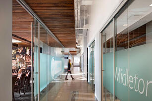 Office Space with Logo on frosted glass walls